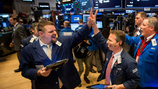 Traders react after the closing bell on the floor of the New York Stock Exchange (NYSE).