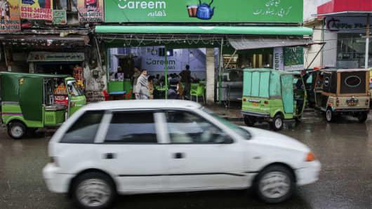 A car travels past a Careem Inc. cafe on Murree Road in Rawalpindi, Pakistan, on Tuesday, Dec. 12, 2017.