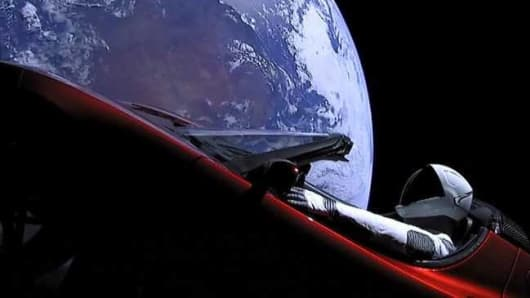 A Tesla Sportster floats past earth after SpaceX Heavy rocket launched from Kennedy Space Center on Feb. 6th, 2018.