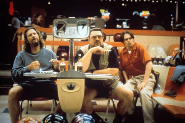"Jeff Bridges as The Dude, a notoriously lazy character, in ""The Big Lebowski,"" alongside John Goodman as Walter Sobchak and Steve Buscemi as Donny Kerabatsos."