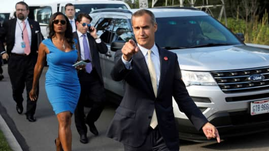 Former campaign manager Corey Lewandowski (C) says hello to reporters as he and White House advisors Sebastian Gorka (from L), Omarosa Manigault and Communications Director Anthony Scaramucci, and staff secretary Rob Porter accompany President Trump for an event celebrating veterans at AMVETS Post 44 in Struthers, Ohio, U.S., July 25, 2017.