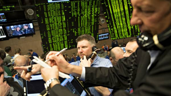 Traders work in the S&P 500 options pit at Cboe Global Markets Inc. in Chicago, Illinois.
