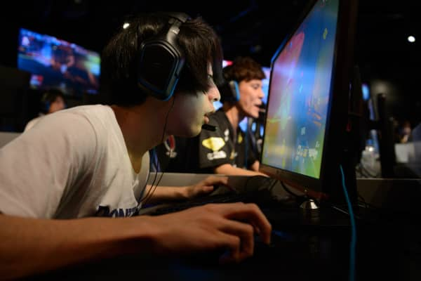 Attendees play Activision Blizzard Inc.'s Overwatch computer game at the AOC Open e-Sports event in Tokyo, Japan.