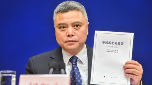 Hu Kaihong, a spokesman of State Council Information Office, shows China's new Arctic Policy at a news conference on January 26, 2018 in Beijing, China.