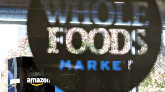 Amazon.com Inc. signage is displayed at a Pop-Up store inside the Lakeview Whole Foods Market Inc. store in Chicago, Illinois, U.S., on Monday, Nov. 20, 2017.