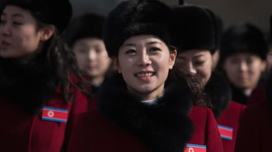 North Korean cheerleaders arrive at a rest stop as their bus convoy carrying a 280-member delegation on its way to the 2018 Pyeongchang winter Olympic games, makes its way past Gapyeong on February 7, 2018.