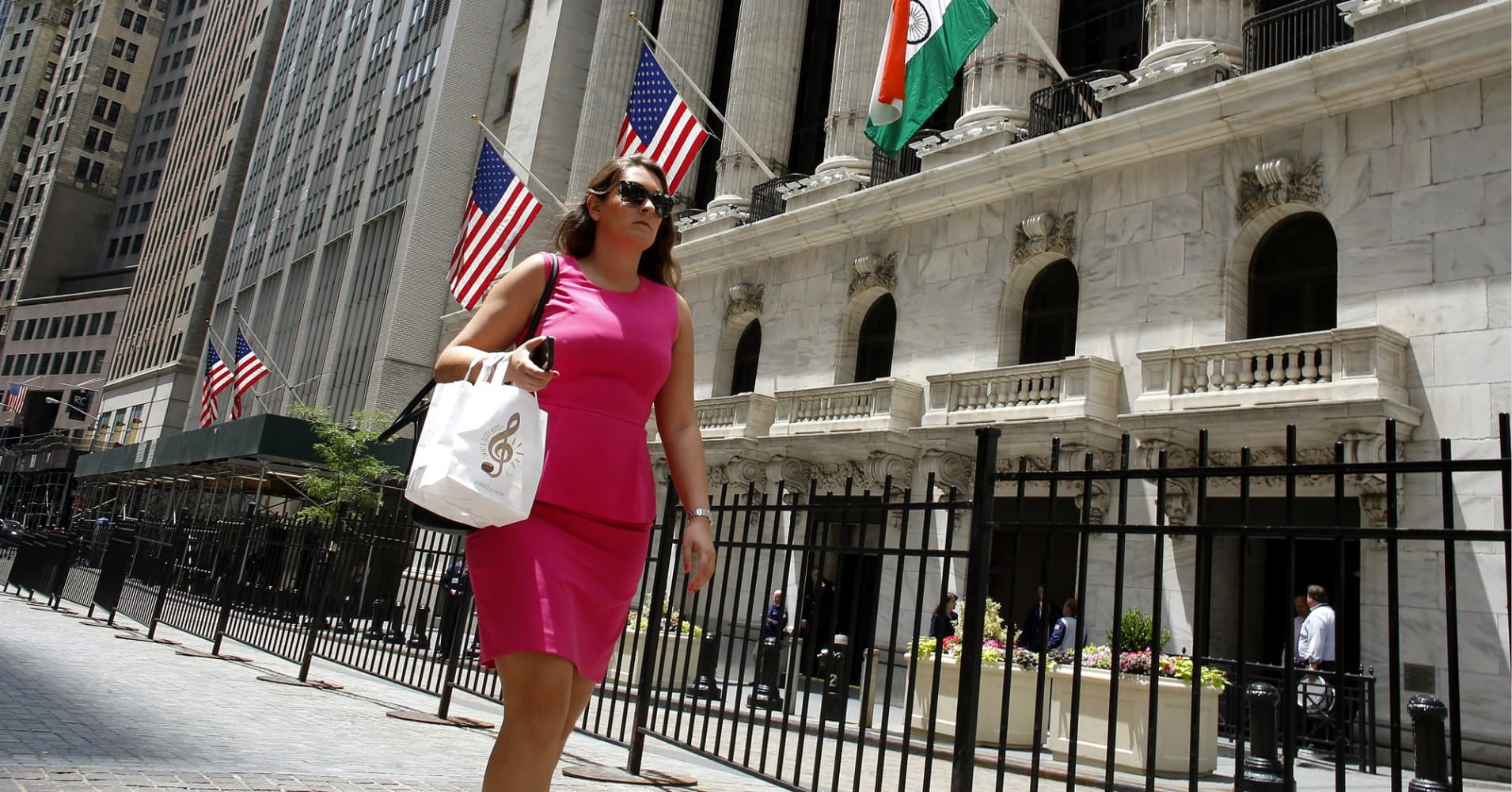 A woman walks by the New York Stock Exchange in New York.