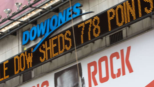 The Dow Jones ticker in Times Square displays news about the stock market in New York.