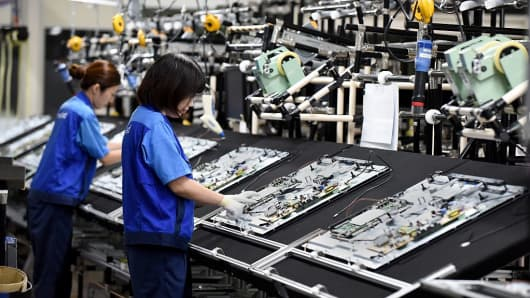 Workers assembling the Panasonic LCD 4K at the Utsunomiya plant in Japan on September 21, 2016.