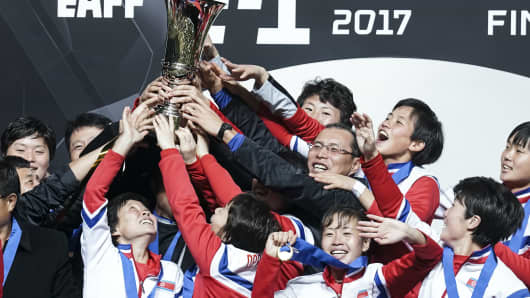 Chiba, Japan - December 15, 2017: North Korean players pose with the trophy as they celebrate winning the women's East Asian Football Championship
