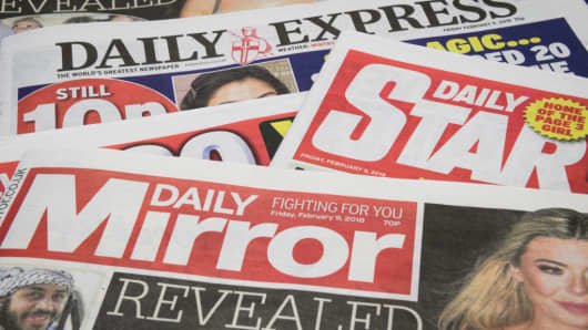 Issues of the Daily Mirror, Daily Star and Daily Express are seen on February 9, 2018 in London.