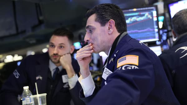 Traders work on the floor of the New York Stock Exchange (NYSE) moments before the Closing Bell.