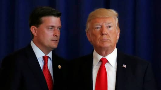 White House Staff Secretary Rob Porter (L) reminds U.S. President Donald Trump he had a bill to sign after he departed quickly following remarks at his golf estate in Bedminster, New Jersey U.S.., August 12, 2017