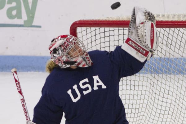 USA Women's hockey goalie Alex Rigsby makes a glove save during the team's evaluation camp at Harold Alfond Forum at the University of New England in Biddeford.