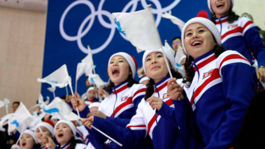 Fans from North Korea wave Korean Unification Flags during a hockey game at the Pyeongchang 2018 Winter Olympics, February 12, 2018.