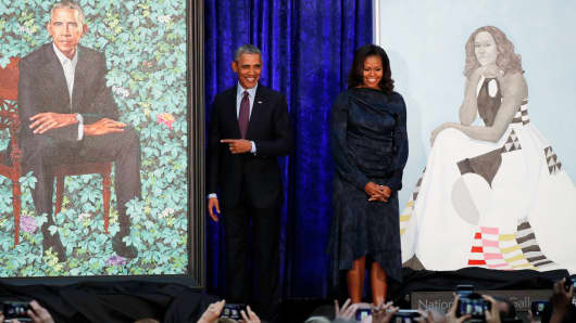 Former U.S. President Barack Obama and former first lady Michelle Obama stand with their portraits during an unveiling ceremony at the Smithsonian's National Portrait Gallery in Washington, U.S., February 12, 2018.