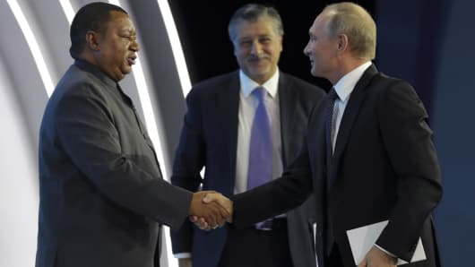 "OPEC Secretary General Mohammad Barkindo described the agreement, which will be reviewed in June, to be ""as solid as the Rock of Gibraltar. Here he is seen shaking hands with Russian President Vladimir Putin (right) at the Russian Energy Week 2017 forum in Moscow in October."