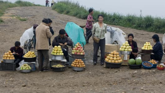 Women gathered at a fruit market in North Korea.