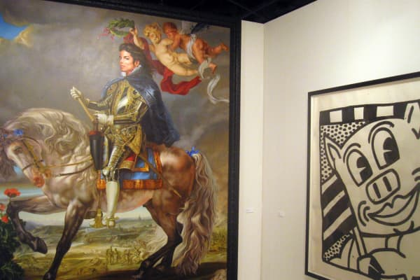 This photo shows Equestrian Portrait of King Philip II, 2009,(L) featuring the late king of pop Michael Jackson, by artist Kehinde Wiley on display December 6, 2009 at the Ar