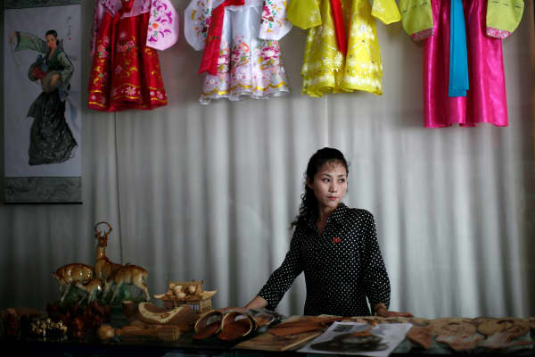 A woman stands in a gift shop in central Rason city, part of the special economic zone northeast of Pyongyang.