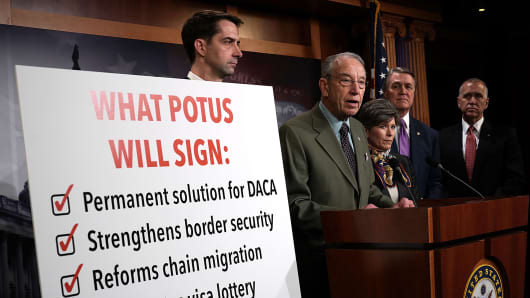 Sen. Chuck Grassley (R-IA) (2nd L) speaks as (L-R) Sens. Tom Cotton (R-AR), Joni Ernst (R-IA), David Perdue (R-GA) and Thom Tillis (R-NC) listen during a news conference on immigration February 12, 2018 at the Capitol in Washington, DC.