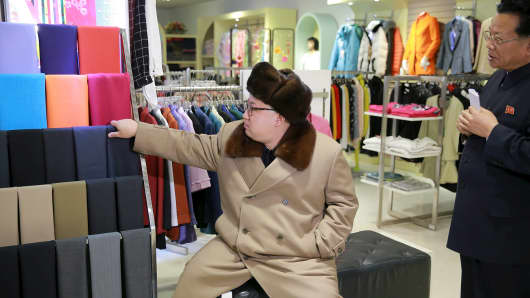 North Korean leader Kim Jong Un gives field guidance at the newly built Mirae Shop and Health Complex.
