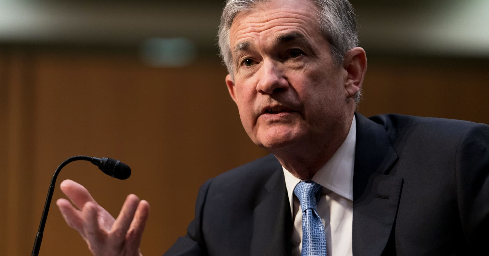 Fed hikes rates, points to two more increases by year's end