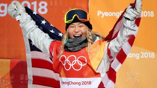 Gold medalist Chloe Kim of the United States celebrates her gold medal win during the Snowboard - Ladies' Halfpipe competition at Phoenix Snow Park on February 13, 2018 in PyeongChang, South Korea.