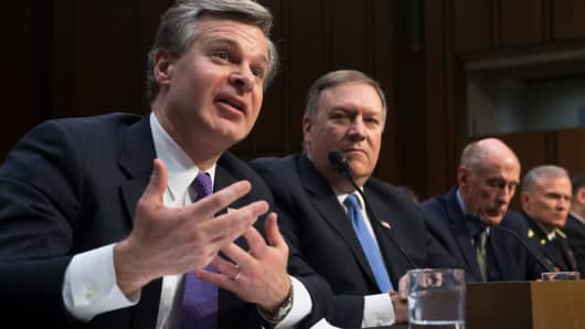 FBI Director Christopher Wray (L) and CIA Director Mike Pompeo (2nd L) testify on worldwide threats during a Senate Intelligence Committee hearing on Capitol Hill in Washington, DC, February 13, 2018.