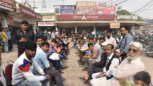 Customers waiting in a queue at Axis Bank branch after the Central Government demonetized the Indian currency of rupees 500 and 1000 after Prime Minister Narendra Modi announced the notes would cease to be legal tender.