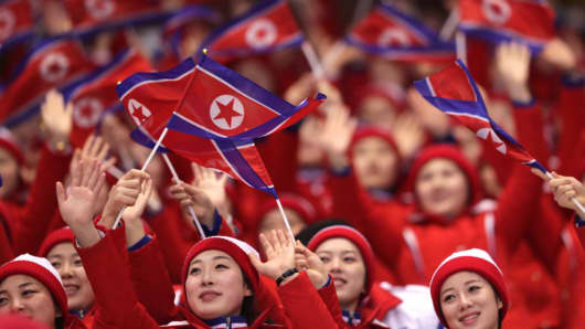 North Korean cheerleaders wave flags at the 2018 PyeongChang Winter Olympics on February 14, 2018.