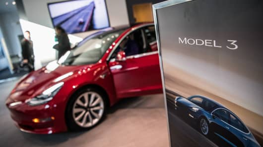 Tesla's new Model 3 car on display is seen on Friday, January 26, 2018, at the Tesla store in Washington, D.C.