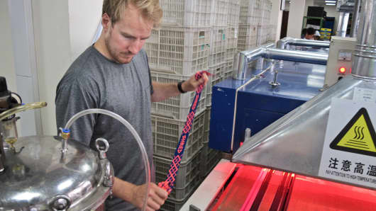 Ted Ligety travels to Asia to visit Shred's factories and oversee production, helping ensure the quality, performance, and style of the brand's products.