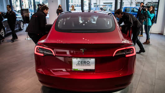 A rear view of Tesla's new Model 3 car on display on Friday, January 26, 2018, at the Tesla store in Washington, D.C.