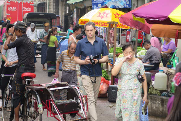 CNBC's Ted Kemp walks through a food market in Yangon, Myanmar.