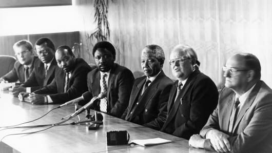 Former South African President Nelson Mandela with (from left) Carl Niehaus, Steve Tshwete, Jacob Zuma, Cyril Ramaphosa, Andries Beyers and Moolman Mentz at discussions between the African National Congress and the Afrikaner Union.