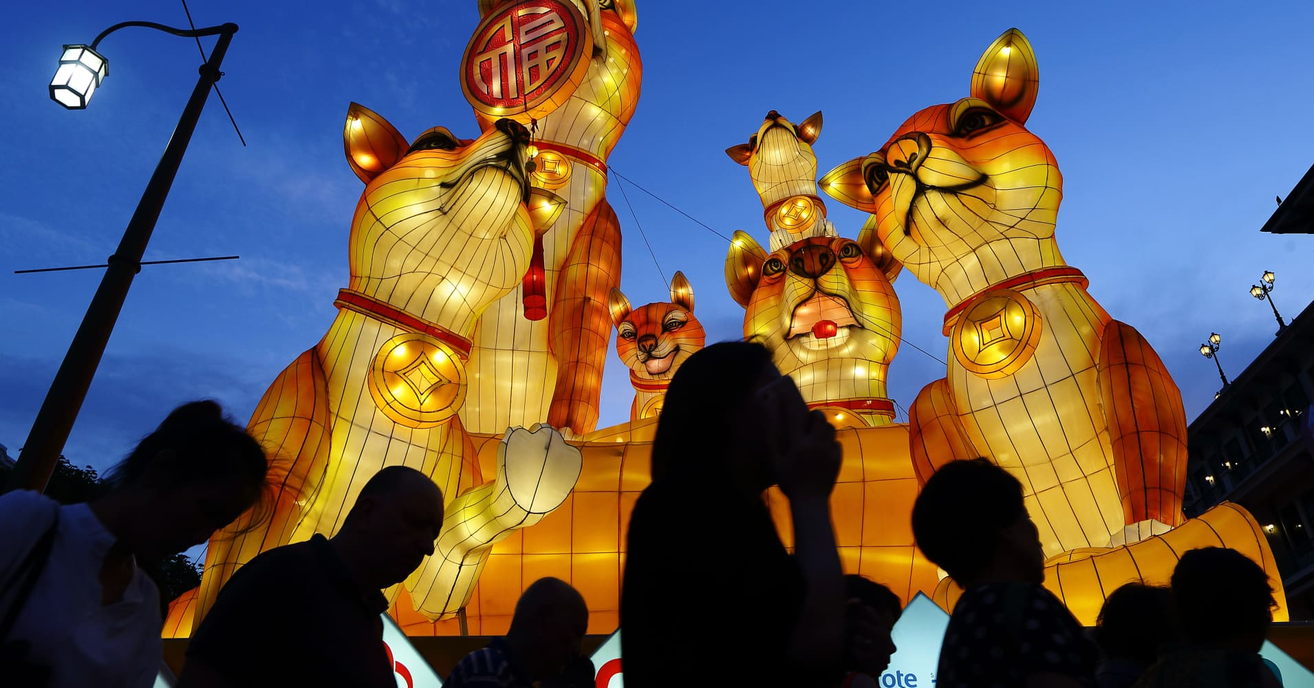 Giant dog lanterns loom over the road at Chinatown on February 14, 2018, in Singapore.