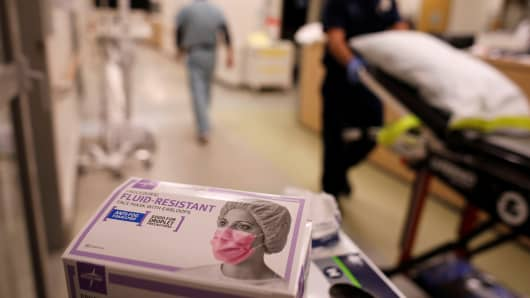 A box of masks is shown in the emergency room at Palomar Medical Center in Escondido, California.