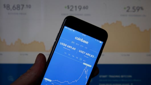 Bitcoin course's graph is seen on the Coinbase cryptocurrency exchange application on February 12, 2018.