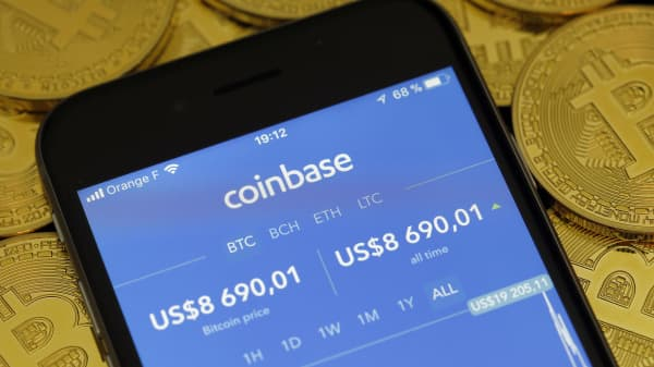 The Coinbase cryptocurrency exchange application seen on the screen of an iPhone.