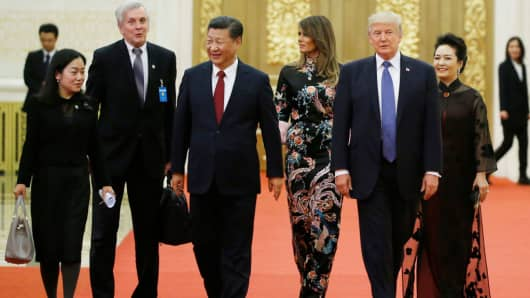 The military aide carrying the nuclear football (second from left) with U.S. President Donald Trump and China's President Xi Jinping at Beijing's Great Hall of the People.