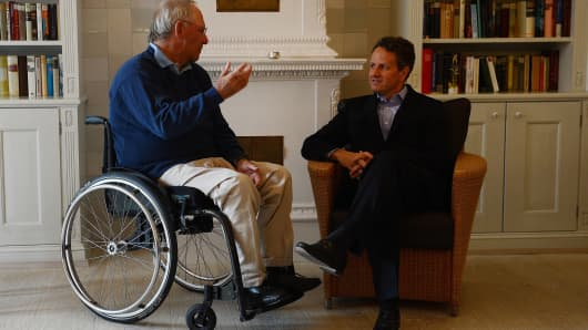 Timothy Geithner (R) talks to Germany's Wolfgang Schaeuble at the Hotel 'Faehrhaus Munkmarsch' on the German North Sea island of Sylt, nothern Germany, on July 30, 2012.