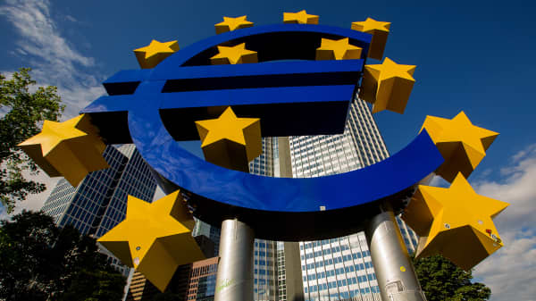 The euro sign sculpture stands outside the former European Central Bank (ECB) headquarters in Frankfurt, Germany, on Sunday, July 3, 2016.