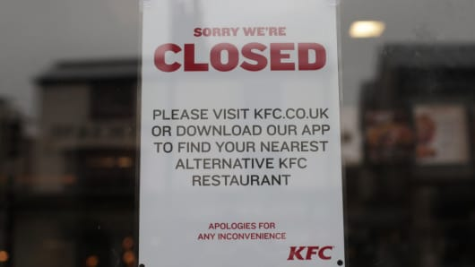 A closed sign on the door of a KFC restaurant in Clapham, south London, as the fast food outlet has been forced to close a raft of stores after a new delivery contract with DHL resulted in chicken shortages across the country.