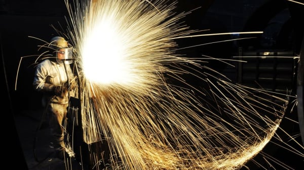 A Chinese worker cutting steel in Qingdao in China's eastern Shandong province.
