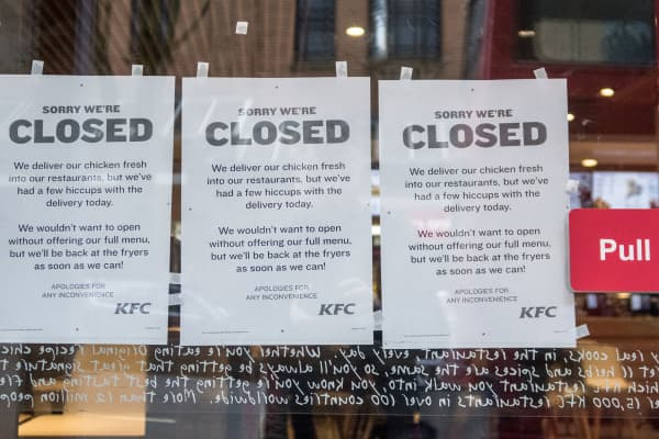 People pass a branch of KFC that is closed due to problems with the delivery of chicken on February 20, 2018 in Bristol, England.