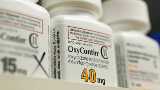 Bottles of prescription painkiller OxyContin made by Purdue Pharma LP sit on a shelf at a local pharmacy in Provo, Utah, April 25, 2017.