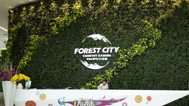 Signage for the Forest City development is displayed at the reception of the Country Garden Holdings Co. property showroom in Iskandar Malaysia zone of Johor Bahru, Johor, Malaysia