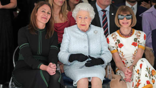 Queen Elizabeth II sits between Anna Wintour (right) and Caroline Rush, chief executive of the British Fashion Council (BFC) (left).