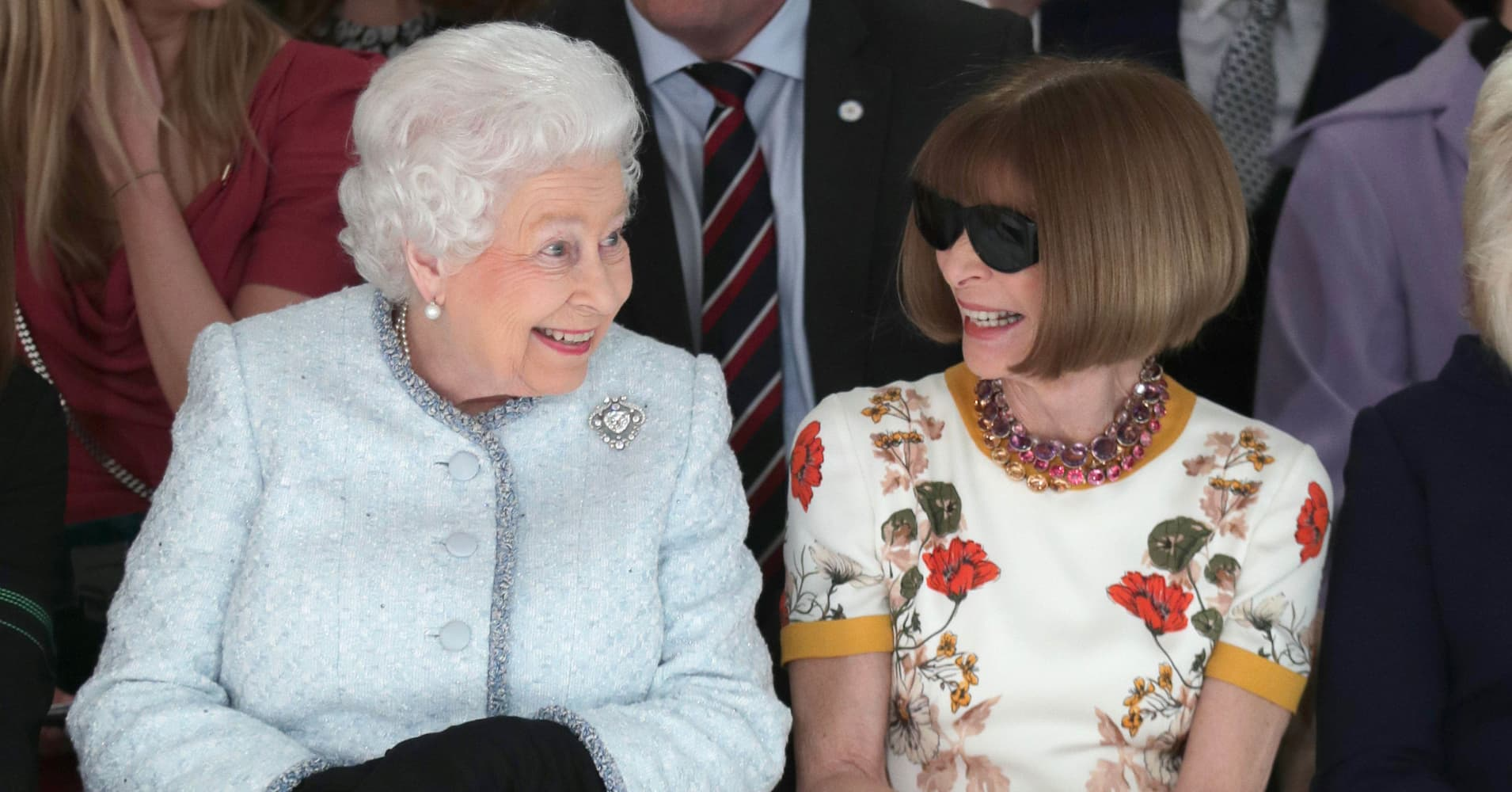 Queen shocks fashion world, joins Vogue's Anna Wintour on the front row at London Fashion Week